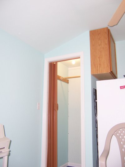 The closet is extra deep to leave room for a tankless water heater and still have plenty of room for clothes.
