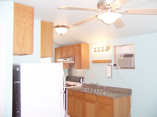 Kitchen has full stainless double sink with garbage disposal and sprayer.
