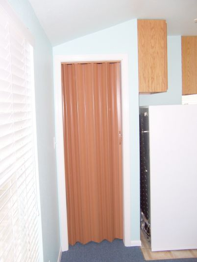 Since this is just a closet and a pocket door was impossible here, we used an accordion folding door to maximize wall space.