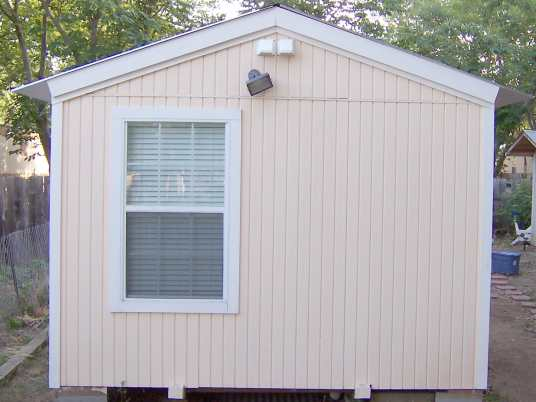 Has 4 inch on center grooved T-111 wood siding. Plywood siding is much better for portable buildings since it braces walls but is flexible enough not to break like cement siding.