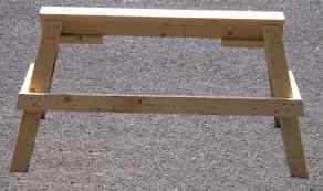 Picture of construction detail of sawhorse showing how top rests on top of leg for extra strength and that legs angle outward to add to stability